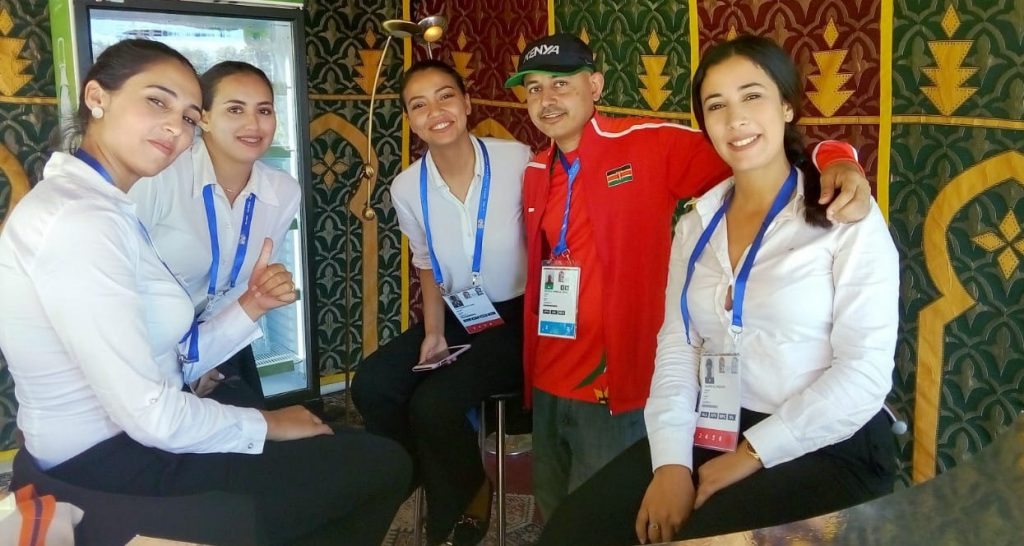 Mehul Gohil posing with some charming volunteers at the 2019 Africa Games in Casablanca.