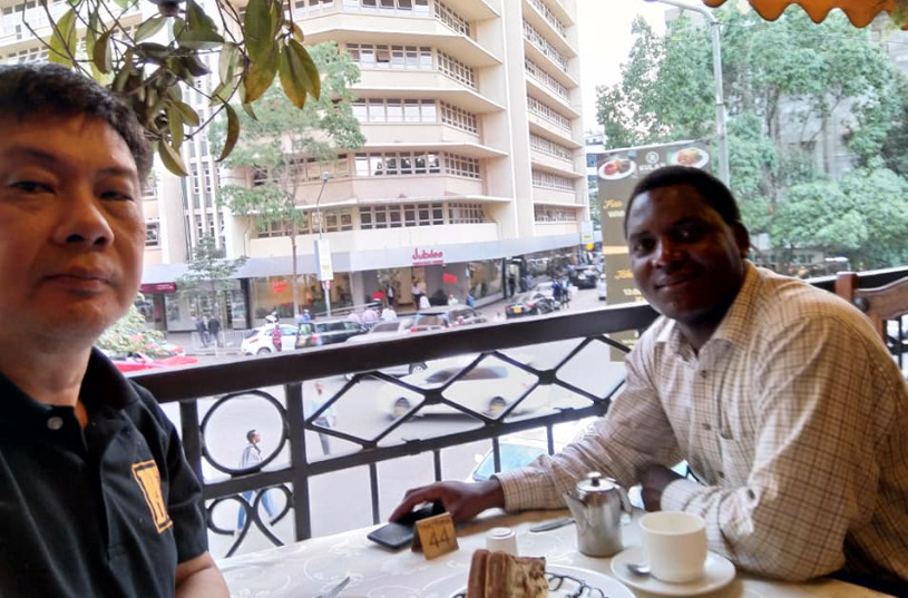 Peter Long having a cup of coffee with IA Duke Michieka who is one of Kenya's top arbiters.