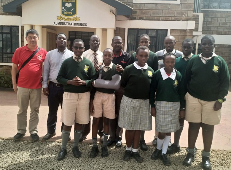 Peter Long (far left) and Duke Michieka (2nd left) pose with the team from St Peter's Juja who took part in the Belaya Ladya Chess Tournaments in Sochi Russia earlier this year.