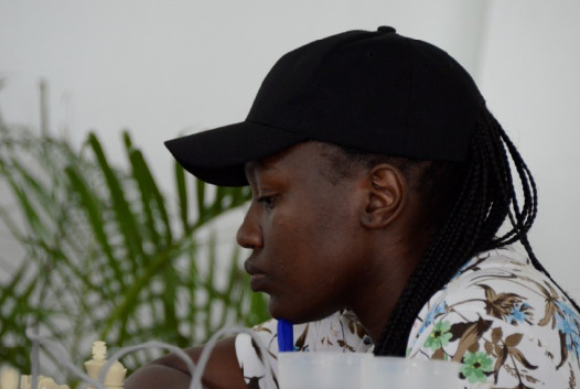 WCM Joyce Nyaruai in action during round 4 of the 2019 Kenya National Chess Championship. Photo credit Kim Bhari.