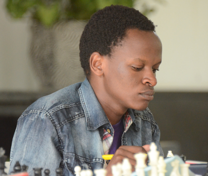 Milton Kihara in action during the 2019 Kenya National Chess Championship.  Photo credit Kim Bhari.