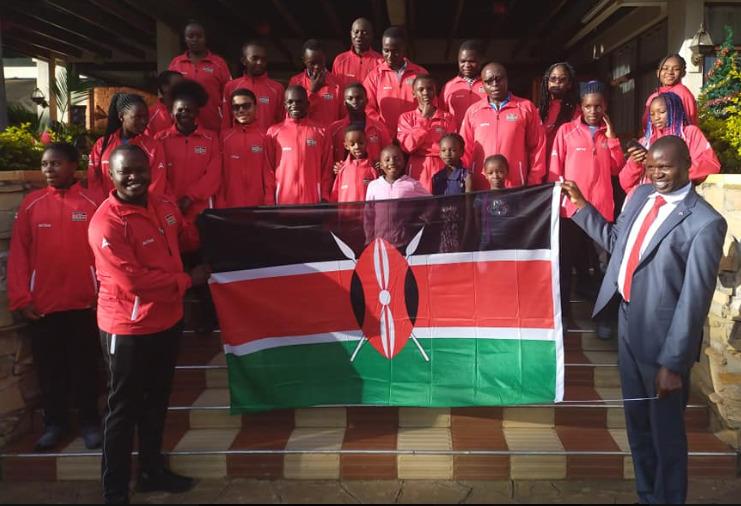 Team Kenya being flagged off. Hold flag on the left is Chess Kenya Vice-President Adnrew Owili and on the right is Chess Kenya President Benard Wanjala.