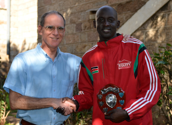 Nairobi Chess Club Treasurer Robeto Villuela presents the winner's shield to James Panchol. Photo credit Kim Bhari.