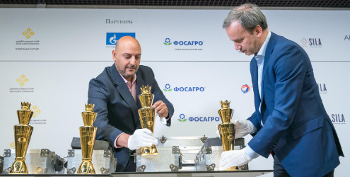 Arkady Dvorkovich FIDE President and Rami Altassan, the President of the Saudi Chess Federation carefully arrange the glittering trophies.