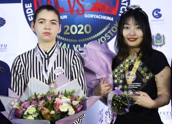World Champion Ju Wenjun and Challenger Aleksandra Goryachkina pose for a photo.