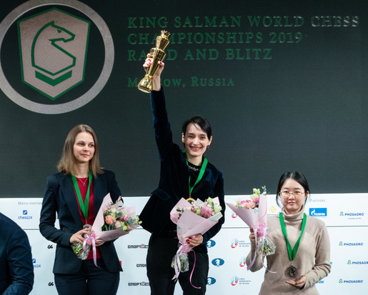 Kateryna Lagno is all smiles while Anna Muzychuk (left) and  Tan Zhongyi looks on.