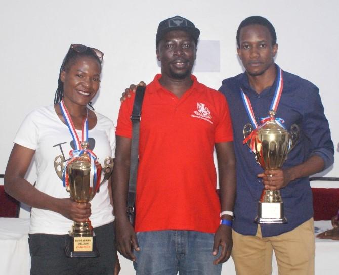Proud winners of the Kantinti Memorial Chess Championship pose with Emmauel Mwaka the Uganda Chess Federation President (middle). Ritah Nsubuga winner of the Ladies section and overall winner FM Patrick Kawuma. Photo credit Uganda Chess Federation.