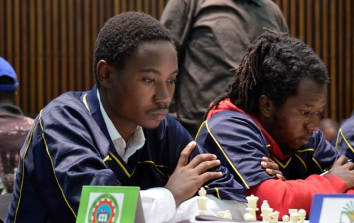 From left Brian Chege and Chris Maina of JKUAT in action during the Kenya Premier Chess League. Photo credit Kim Bhari.