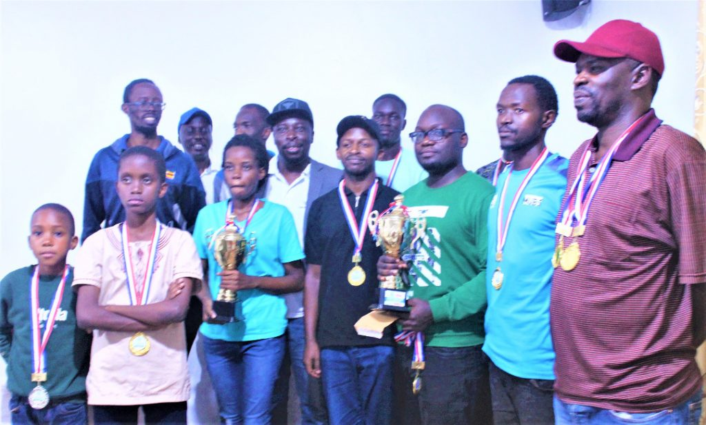 Proud winners pose for a group photo. Photo credit Uganda Chess Federation.