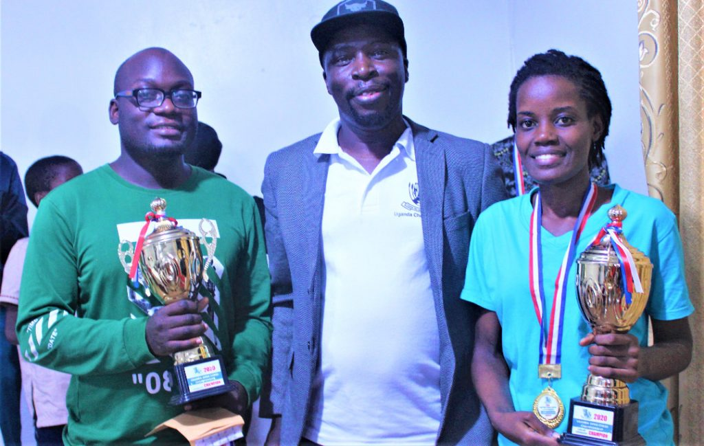Winner of the Uganda Open IM Arthur Ssegwanyi poses with the Uganda Chess Federation President Emmanuel Mwaka and Ladies Winner Damalie Natembo. Photo credit Uganda Chess Federation.