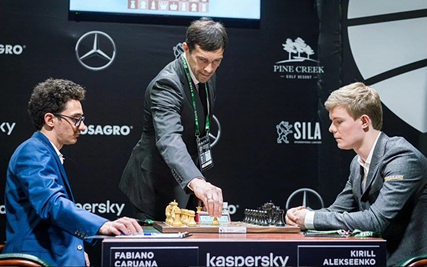 Pavel Datsyuk makes the first move in the game between Fabiano Caruana and Kirill Alekseenko.