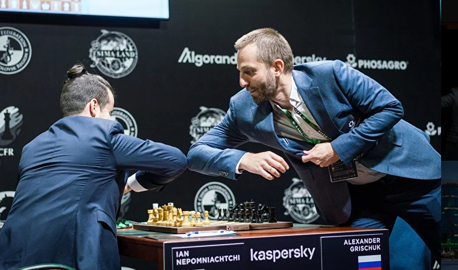 Ian Nepomniachtchi and Alexander Grischuk do the 'elbow shake'!  Will this be the new style for chess players?