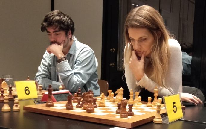 IM Alberto Chuec (board 6) and WGM Sophie Milliet (board 5) both of L'Escola D'Escacs De Barcelona. Photo credit Kim Bhari.