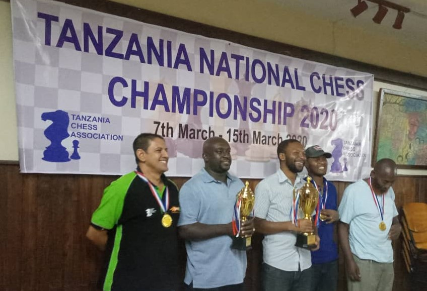 Winners pose for a group photo from left Sharif Rashid Mansour (5th), Geoffrey Mwanyika (2nd), FM Hemed Mlawa (winner), Albert Njau (3rd) & CM Yusuf Mdoe (4th). Photo credit Tanzania Chess Association.