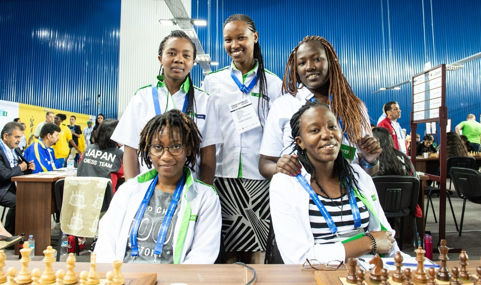 A great photo of Team Kenya at the 2018 Batumi Olympiad. Sitting from left WCM Lucy Wanjiru, Gloria Jumba, standing from left WFM Sasha Mongeli, Daphne Mwikali, WCM Joyce Nyaruai.