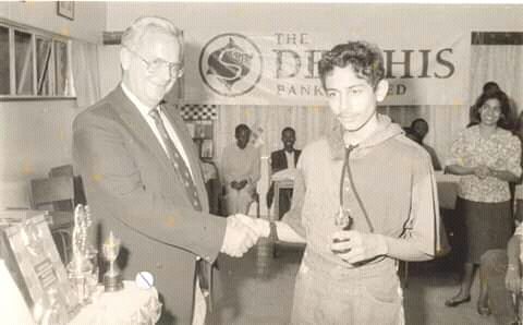 The late MD Mr John Barnes of Delphis Bank who were the proud sponsors of the 1994 Kenya National Chess Championship presents the prize for top junior to Mehul Gohil!