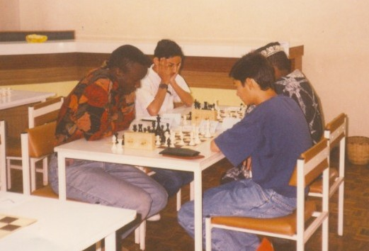 Mehul Gohil in white shirt in action against the late Andolo Ambasi at the United Kenya Club during a tournament held on 4th February 1994.