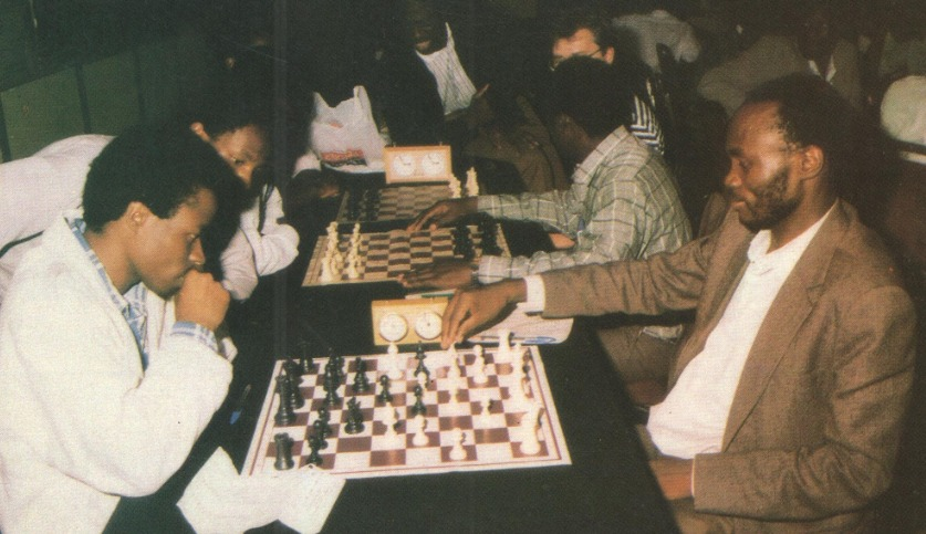 Humphrey Andolo (left) takes on Silver Kamuhangire of Uganda during the 1992 Kenya Open. Photo credit unknown.