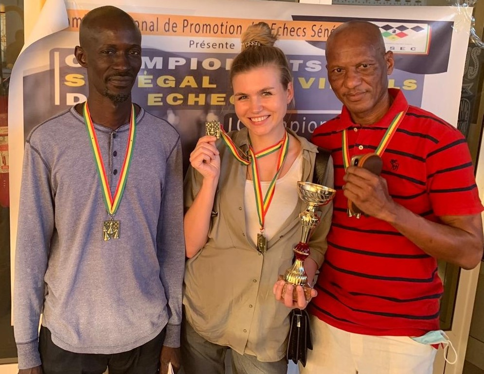 Happy winners pose with their medals - standing from left Wara Diop, Nadezda Marochkina and winner Mansour Gbedo Sy. Photo credit Senegal Chess Federation.