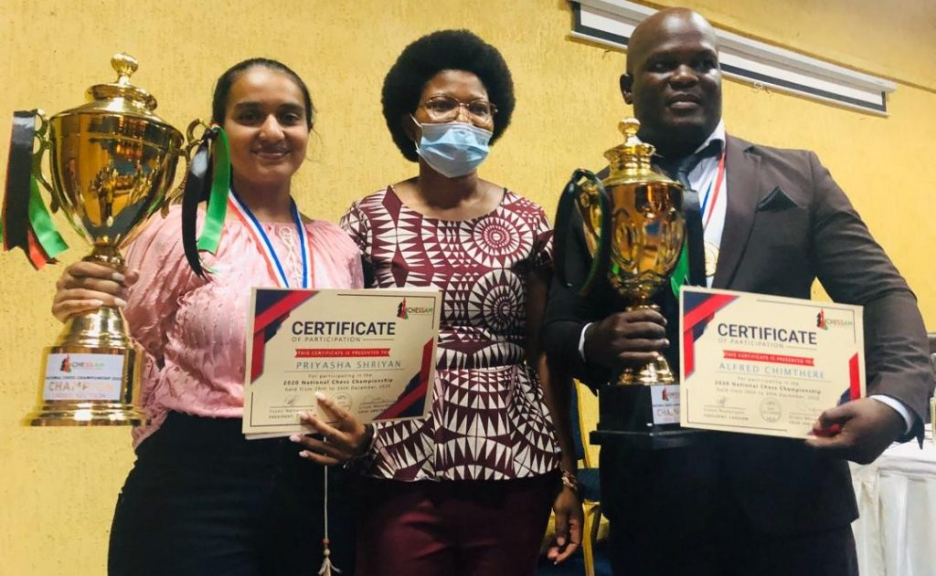 Proud winners Priyasha Shriyan who won the Ladies Section (left), President of the Chess Association of Malawi Ms Susan Namangale, and , CM Alfred Chimthere the winner of the Open Section.
