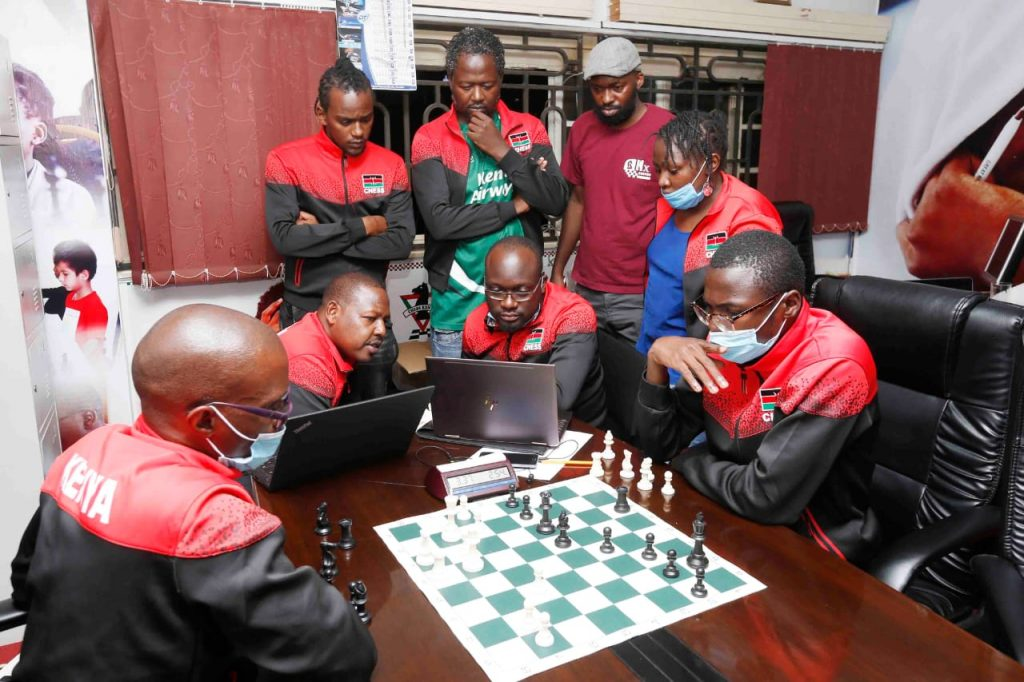 IM Arthur Ssegwangyi of Uganda (sitting third from left) in a training session with Team Kenya. Photo credit Benard Wanjala.