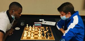 Jossy Uapingene left takes on IM Dante Beukes in their encounter. Photo credit Namibian Chess Federation.