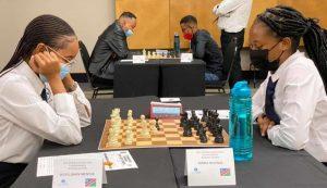 WCM Lishen Mentile (left) takes on Maria Niilenge . Photo credit Namibian Chess Federation.