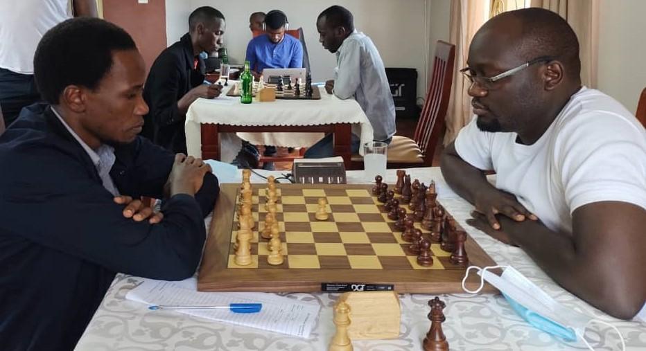 The game that decided everything! FM Patrick Kawuma (left) takes on IM Arthur Ssegwanyi. Photo credit Namwanza Kennedy.