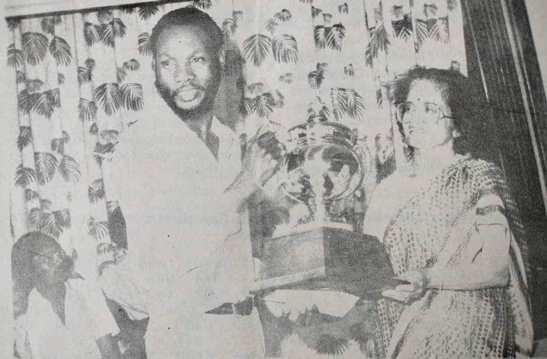Emmanuel Kabuye receives the Kenya Open trophy during one of the past editions.
