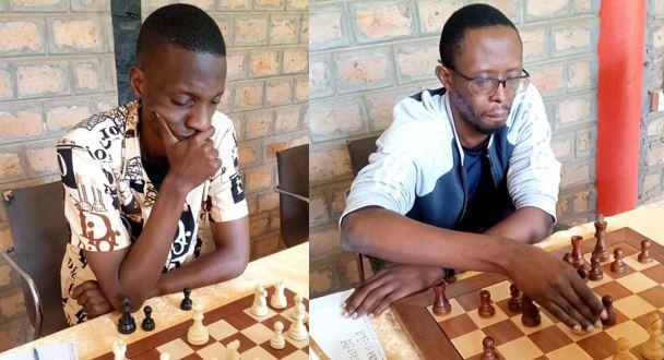 FM Haruna Nsubuga (left) and FM Harold Wanyama adjusts his pieces. Photo credit Namwanza Kennedy.