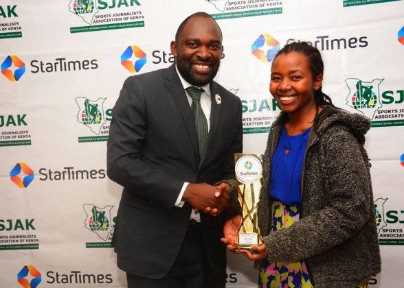 Star Times Director of Marketing and PR, Mr. Japheth Akhulia presents Sasha Mongeli with her prize. Photo credit Star Times.