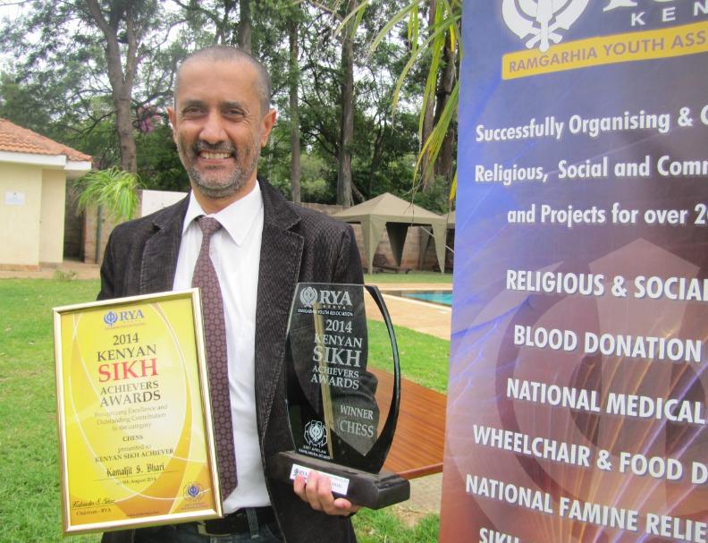 Kim Bhari with his award from the Ramgarhia Youth Association.