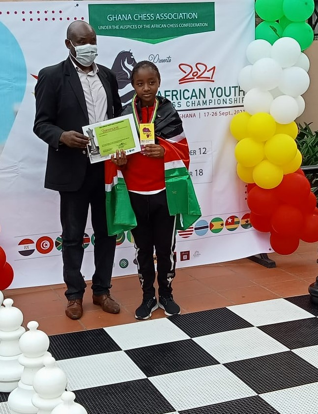 Elizabeth Cassidy Maina receives her prize at the 2021 African Youth Chess Championship in Accra, Ghana. Photo credit Rodah Etole.