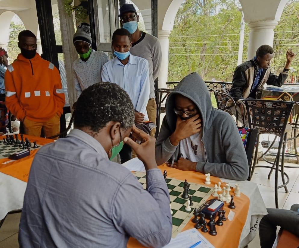 Dominic Nyonge (with hoddie) versus CM Ben Magana at the Scottish Tartan Hotel in Kisumu.